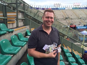 At the Foro Sol stadium, holding 10 tickets representing all the ballparks Joseph has seen so far